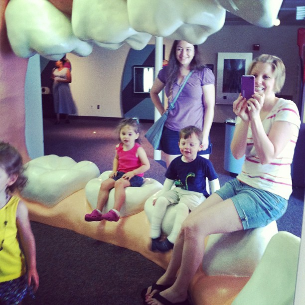 Patrice, Jonah, and their friends smile at the science museum.