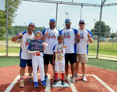 Belonging \ Epidermolysis Bullosa News \ Jonah and his brother, Gideon, pose at home plate with their coaches following a recent championship win